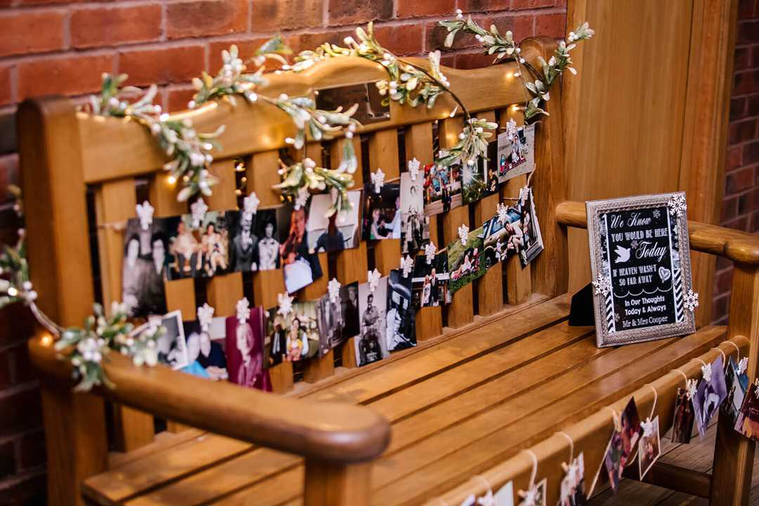 Emmas fathers bench with photos and decorations