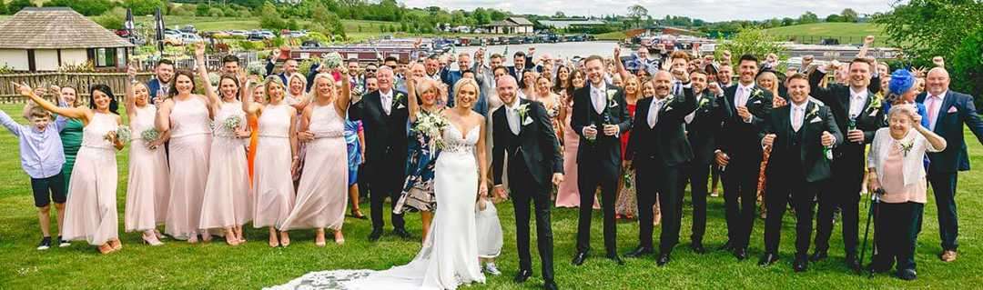 Alicia and Lewis with all wedding guests